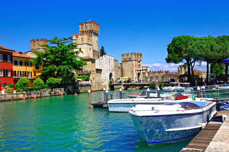 Beautiful Lake Garda, view of Rocca Scaligera in Sirmione village, Italy.