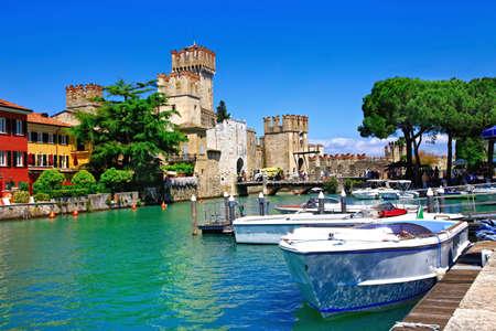 Beautiful Lake Garda, view of Rocca Scaligera in Sirmione village, Italy.