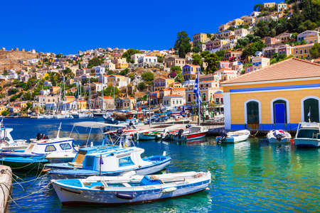 Picturesque symi island, view of fishing boats and houses, Greece. Stock Photo
