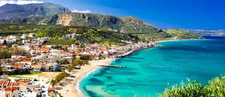 Beautiful Kalyves village, azure sea and mountains, Crete island, Greece.