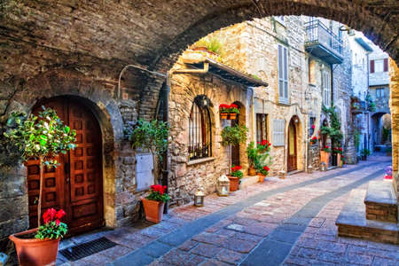 Old streets of Italy with floral decoration,Assisi,Umbria.