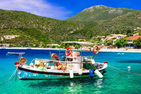 Traditional fishing boat in Mikros Gialos, Lefkada Island, Greece. Stock Photo