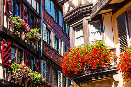 Traditional colored houses and flowers in Colmar town, Alsace, France. Stock Photo