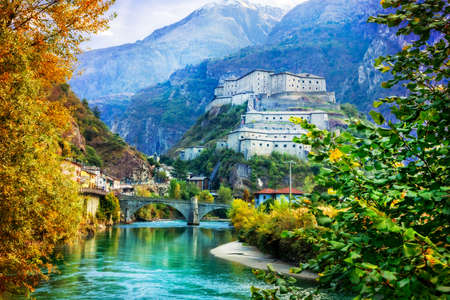 Impressive Bard fortress, view with river, bridge and mountains, Valle dAosta, Italy.