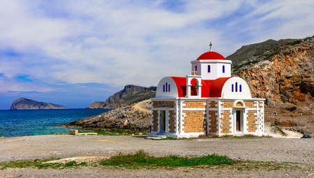 Traditional church, azuresea and mountains, Crete island, Greece.