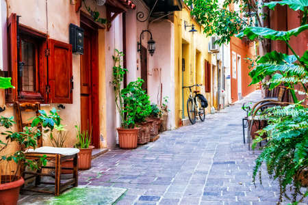 Old streets of Greece, View with old bike and flowers.