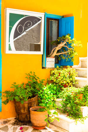 Old streets of Greece, view from the floral decoration, Naxos. Stock Photo