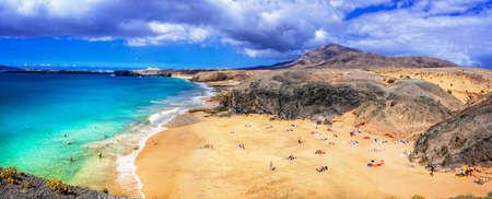 Beautiful Papagayo beach, azure sea and mountains, Lanzarote island, Spain. Stock Photo