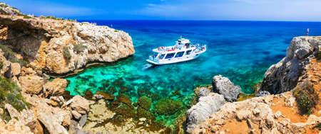 Incredible nature in Agya Napa, azure sea, unique rocks and boat, Cyprus island.