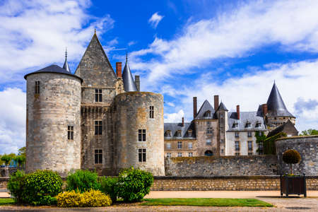 Elegant Sully-sur -Loire castle, view with gardens, France.