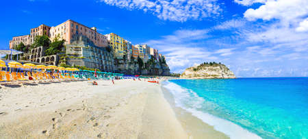 Traditional colorful houses in Tropea village, view with azure sea, Calabria, Italy. Redakční