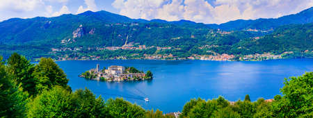 Impressive Orta San Giulio village, view with lake and mountains, Piemonte, Italy.