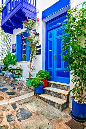 Old streets of Greece, view with door, window and flowers.