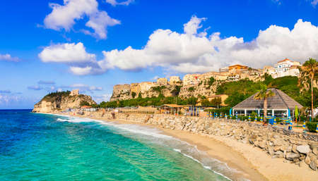 Turquoise sea, golden sand and houses in Tropea village, Calabria, Italy Banco de Imagens