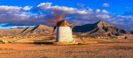 Traditional windmill and mountains in Fuerteventura island, Spain Banco de Imagens