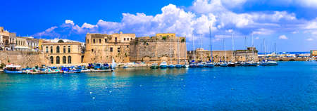 Traditional houses and old castle, Gallipoli, Puglia, Italy.