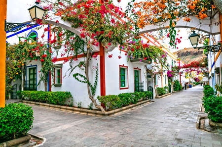 Traditional houses and flowers in Puerto de Mogan, Gran Canaria, Spain.