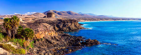Beautiful El Cotillo village, view with azure sea and mountains, Fuerteventura, Spain.