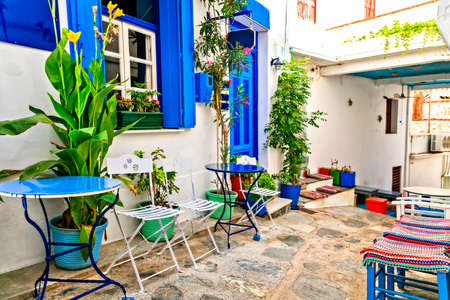 Old streets of Skopelos, View with traditional bar and tavern, Greece Banco de Imagens