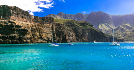 Turquoise sea and mountains in Puerto de las Nieves village, Gran Canaria, Spain