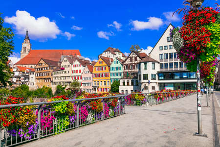 Traditional colorful houses and flowera in Tubingen town, Germany