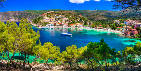 Traditional turquoise sea houses in Assos village, Kefalonia island, Greece