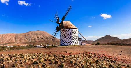 Traditional windmill and mountains, Fuerteventura island, Spain.