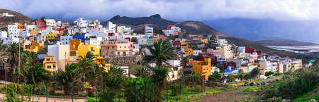 Traditional colorful houses in Puerto de Sardina, Gran Canaria, Spain.