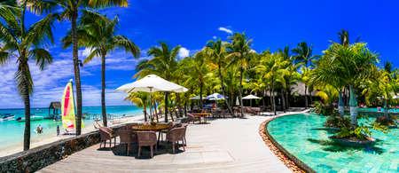 Luxury swimming pool in Tropical paradise, Mauritius island Editorial