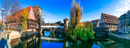 Beautiful Nuremberg town, view with old bridge and traditional houses, Bavaria, Germany