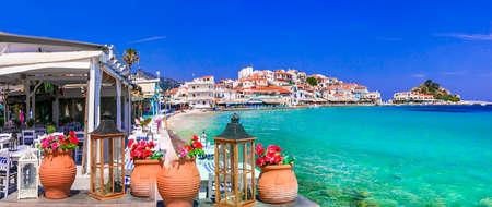 Turquoise sea and colorful houses in Kokkari village, Samos island, Greece.
