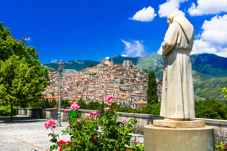 Impressive Morano Calabro village, view with Padre Pio statue and flowers