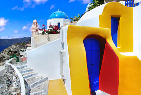 Colorful houses and little church in Santorini island, Greece.