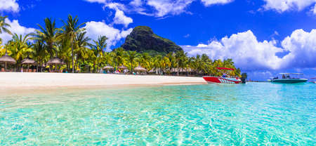 Turquoise sea, white sand, palm trees and mountain, Le Morne, Mauritius. Stock Photo