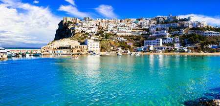 beautiful white town on the rock and traditional coastal village - Peschici in Puglia, Italy. Italian summer holidays