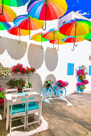 Charming bar decoration design in retro style with old bicycle,umbrellas and flowers Stock fotó