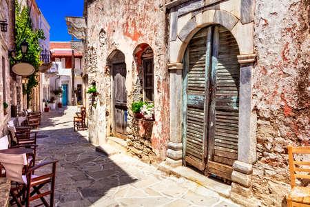 Traditional Greece. Typical street cafe bars. Halki village. Naxos island, Cycades. Stock Photo