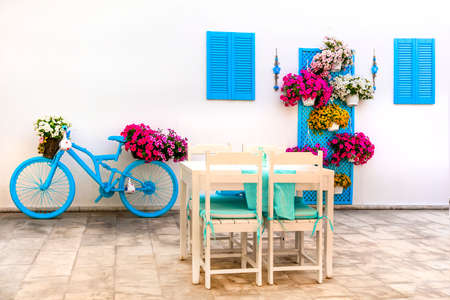 Charming bar decoration design in retro style with old bicycle and flowers