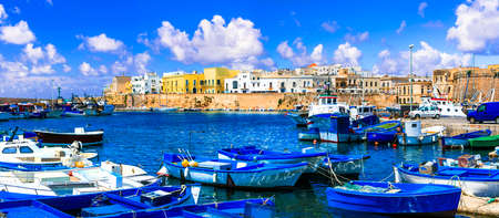 Italy travel. Gallipoli town. view of medieval castle and port with fishing boats