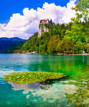 Most beautiful lakes of Europe - Bled in Slovenia with clear waters and splendid medieval castle over rock Stock fotó