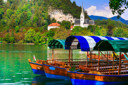 Wonderful lake Bled in Slovenia - one of the most beautiful in Europe. Traditional wooden boats trip