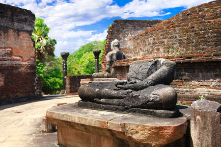 Sri Lanka travel and landmarks -  ancient city of Polonnaruwa. Buddha statue' ruins in Vatadage temple
