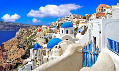 Iconic Santorini - most beautiful island in Europe. view with traditional churches in Oia village. Greece