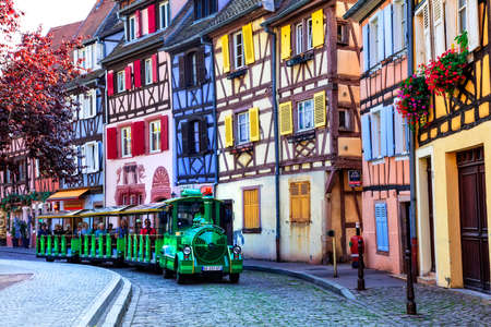France travel. Most beautiful and colourful towns. Colmar in Alsace region. Tourist sightseeing train. September 2016