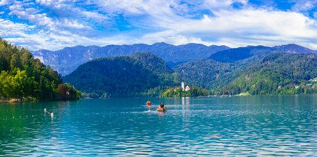 Idyllic nature scenery - beautiful magic lake Bled in Slovenia. Canoe acitivity. September 2019