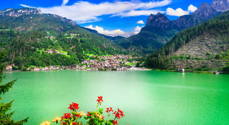 Amazing alpine scenery, Dolomites mountains. Beautiful lake lago di Alleghe, northern Italy (Belluno province) Zdjęcie Seryjne