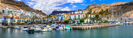 best of Grand  Canary (Grand Canaria) - beautiful traditional fishing village Puerto de Mogan. popular tourist destination, Canary islands. Panoramic view of marine .24.01.2019 Publikacyjne
