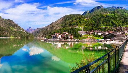 Amazing alpine scenery, Dolomites mountains. Beautiful lake and village Lago di Alleghe, northern Italy (Belluno province)