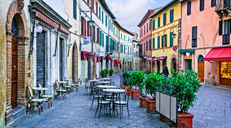 Charming streets with bars in narrows alleys of italian towns. Montalcino in Tuscany. Italy