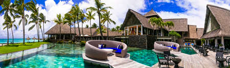 luxury 5 star hotel territory with swimming pool and bar zone - Constance Belle Mare Plage. Mauritius island. Pointe de flacq, Belle Mare. February 2020 Publikacyjne